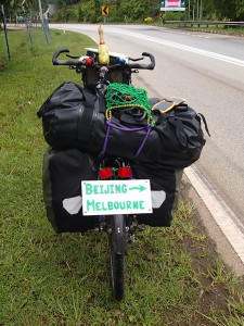 While I was recuperating in Thailand, I made a new cargo net and sign for the back of the bike. Not sure why the load looks so unbalanced in this pic...