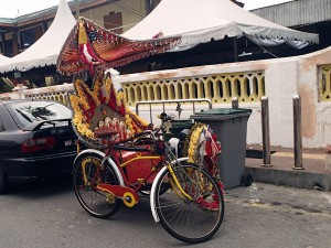 The rickshaws in Melaka are covered in bling and play disco music at high volume as the transport tourists around Melaka. Tarquin was quite impressed and requested I camp-up my bike a little. I declined.