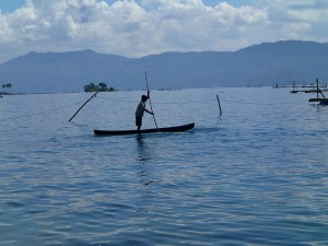 A boatman out checking his nets on Lake Toba.