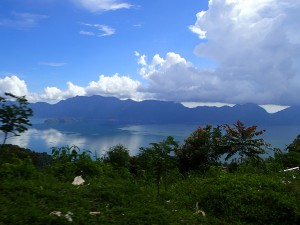 "A snap I took of the crater lake (Danau Maninjau), while speeding down the ""44 bends"" to the lake shore"