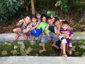 Some Indonesian kids watching as we try to hitch a lift in Sumatra