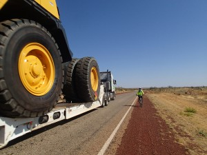 Dwarfed by a dumptruck being transported along the Stuart Highway, Mum holds her breath and hopes for the best.